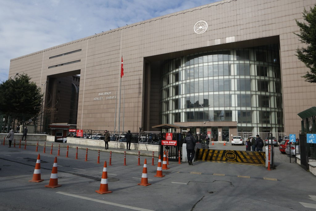 Security officials check people's IDs before the third hearing in the trial of Carlos Ghosn, former Nissan Motor Co. chairman, in Istanbul, Wednesday,...