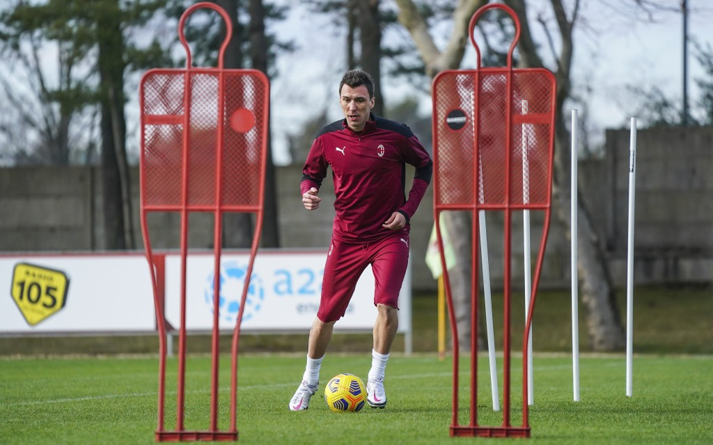 Mario Mandzukic attends his first training session at the Milanello Milan's sport center, in Carnago, Italy, Tuesday, Jan. 19, 2021. AC Milan has sign...