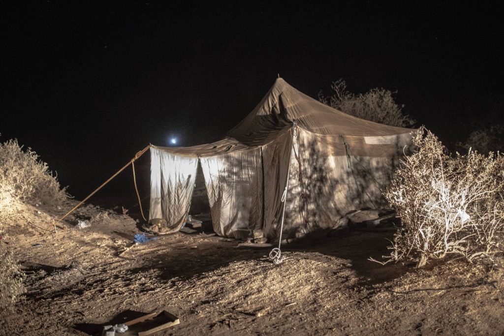 A tent where smugglers stay while building fishing boats to be used to carry migrants to the Canary Islands, is set up in a remote part of the desert ...