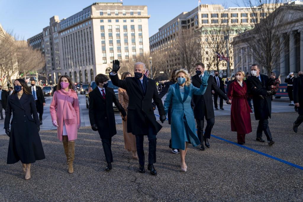 President Joe Biden, First Lady Jill Biden and family, walk near the White House during a Presidential Escort to the White House, Wednesday, Jan. 20, ...