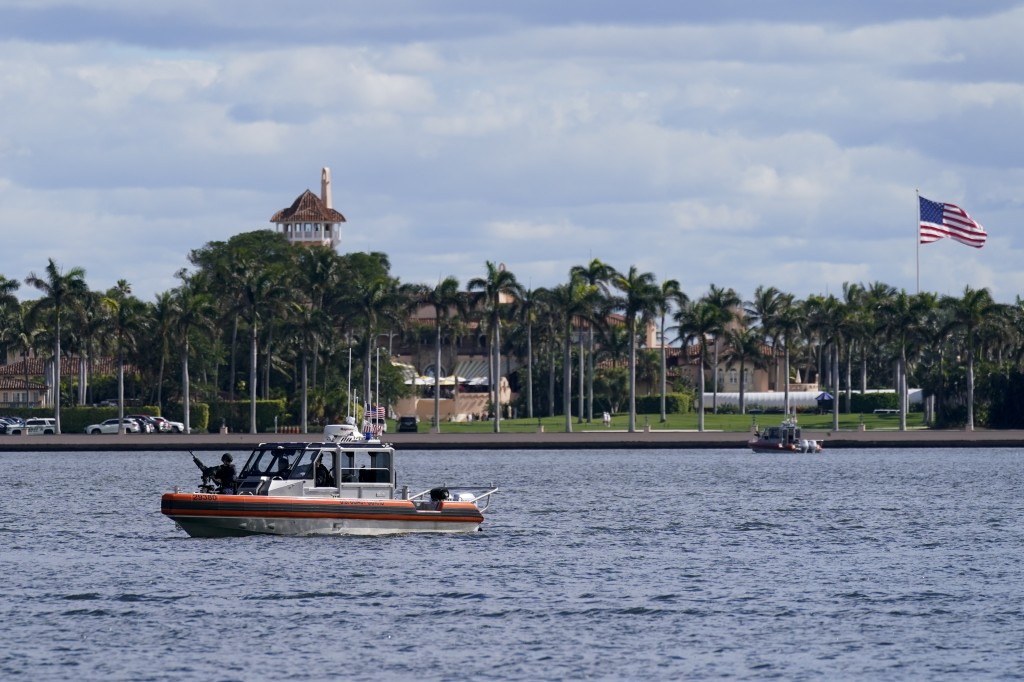 The security boat patrols near Mar-a-Lago Florida Resort on Wednesday, Jan. 20, 2021, in West Palm Beach, Fla. (AP Photo/Lynne Sladky)