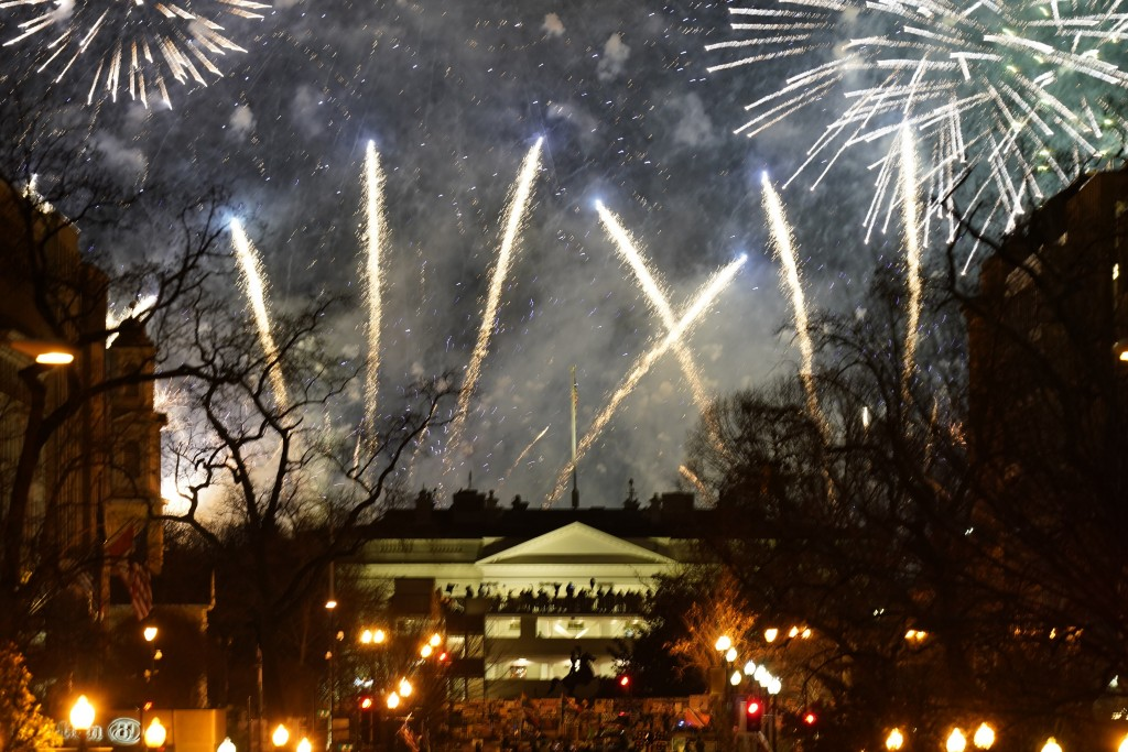 Fireworks light up the sky around the White House, Wednesday night, Jan. 20, 2021, in Washington, as part of the festivities after President Joe Biden...