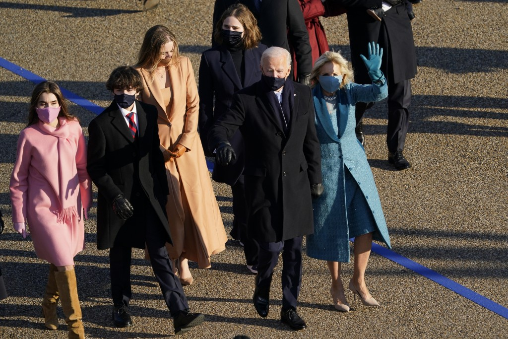 President Joe Biden and his wife Jill Biden walk in a parade during the Presidential Escort, part of Inauguration Day ceremonies, Wednesday, Jan. 20, ...