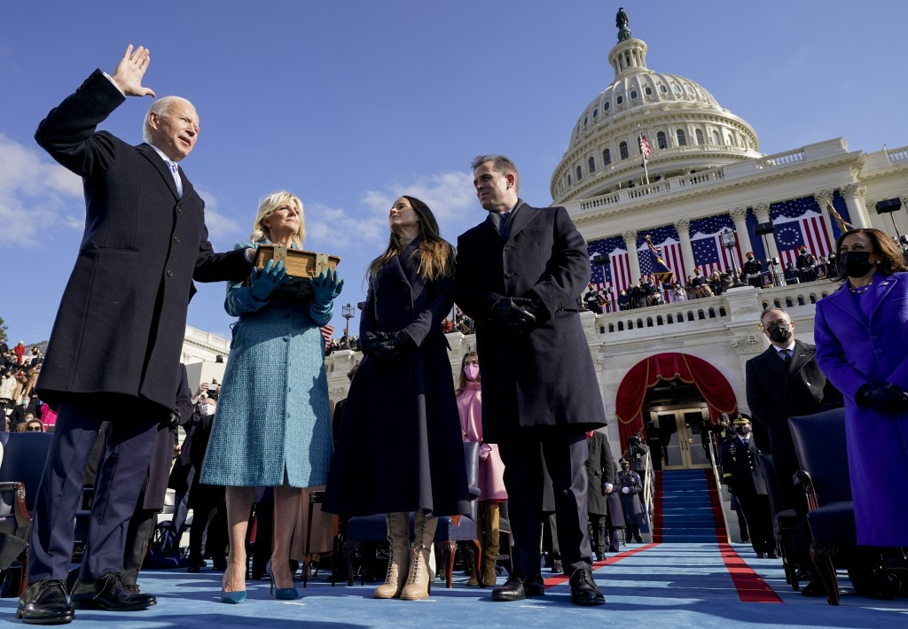 Joe Biden is sworn in as the 46th president of the United States by Chief Justice John Roberts as Jill Biden holds the Bible during the 59th President...