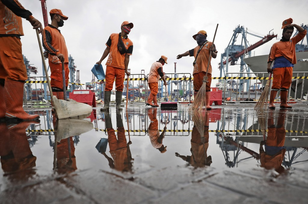 Workers dry a dock at the Tanjung Priok Port where the command center for the search and rescue mission for Sriwijaya Air flight SJ-182 that crashed i...