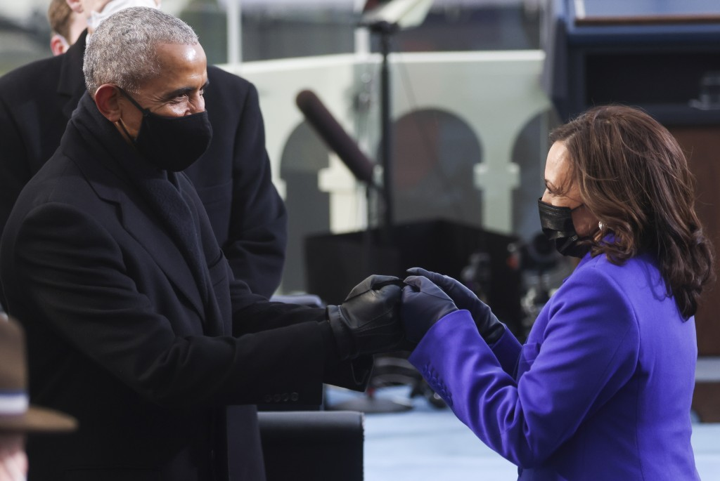 Former President Barack Obama greets Vice President-elect Kamala Harris ahead of President-elect Joe Biden's inauguration, Wednesday, Jan. 20, 2021, a...