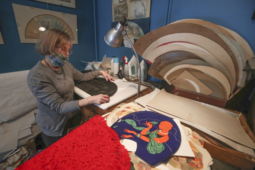 Anne Hoguet, 74, fan-maker and director of the hand fan-making museum works in her workshop in Paris, Wednesday, Jan. 20, 2021. Just like the leaves o...
