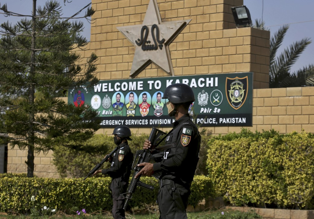 Pakistan police commandos stand guard outside the National Stadium, where the Pakistan Cricket Team is practicing for the upcoming test match against ...