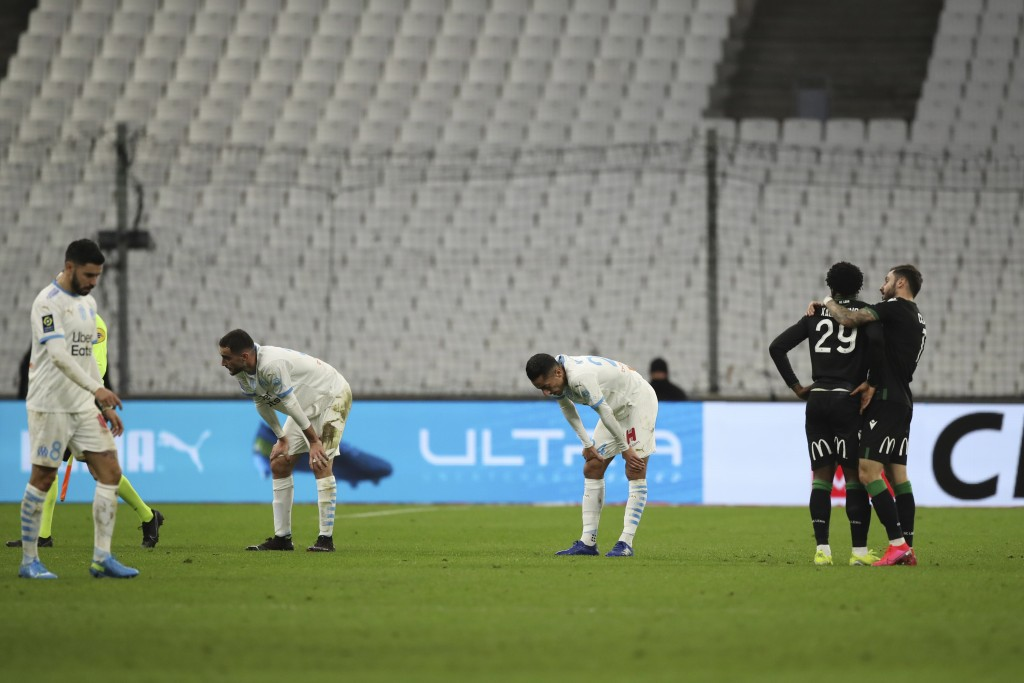 Marseille players react after the French League One soccer match between Marseille and Lens at the Veledrome stadium in Marseille, France, Wednesday, ...