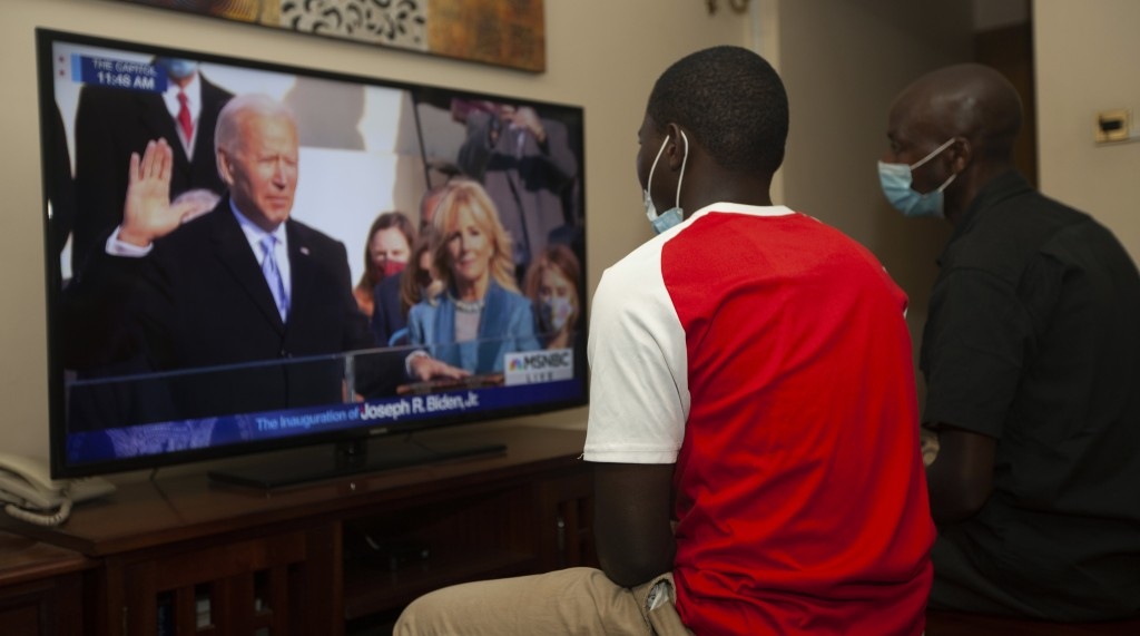 Kenyans watch President-elect Joe Biden's inauguration on the television, in Nairobi, Wednesday, Jan. 20 2021. Biden has officially become the 46th pr...