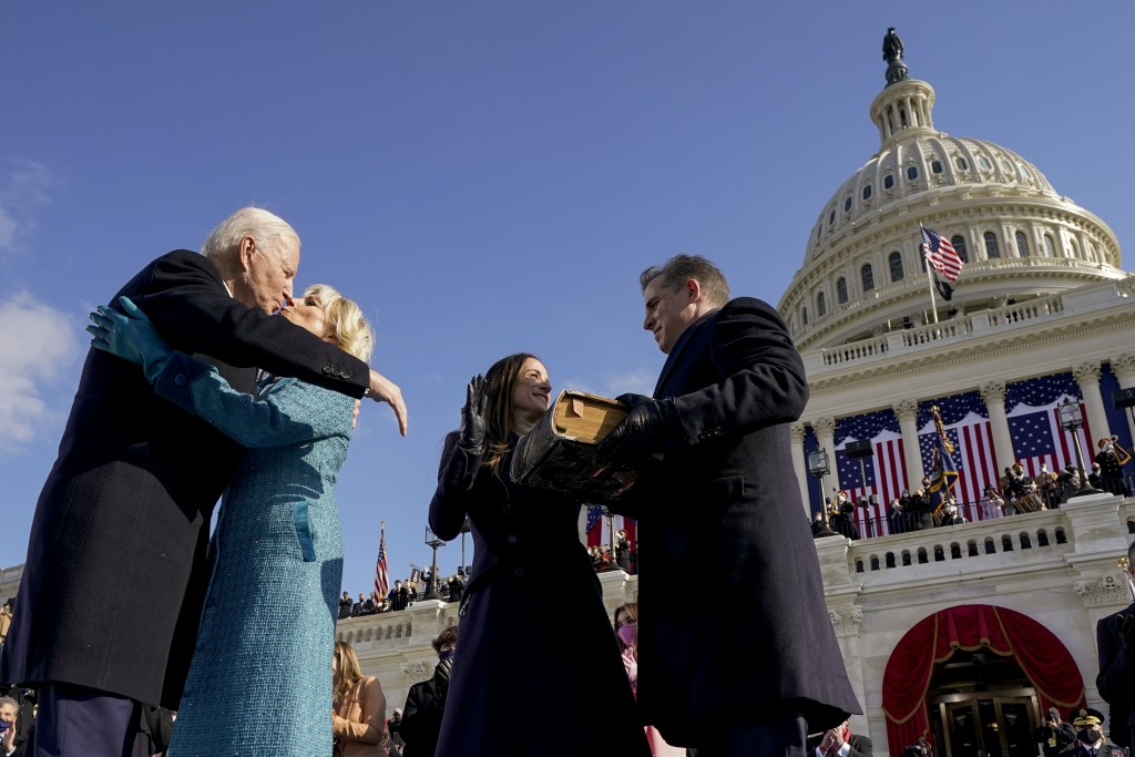 President Joe Biden and first lady Jill Biden, kiss as his son Hunter Biden and daughter Ashley Biden look on after being sworn-in during the 59th Pre...