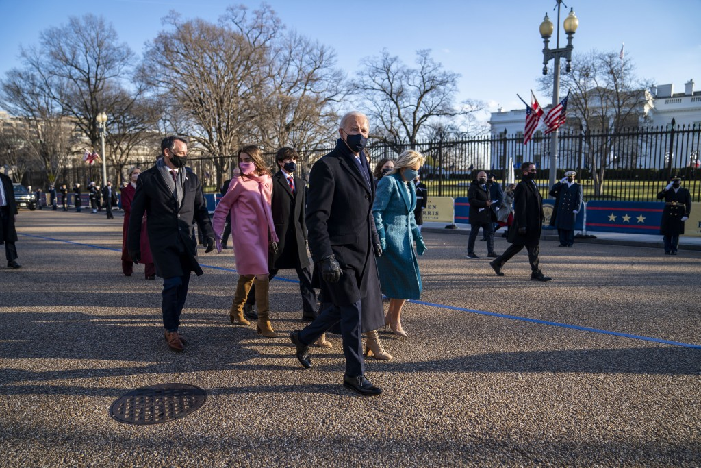 President Joe Biden, First Lady Jill Biden and family, walk in front of the White House during a Presidential Escort to the White House, Wednesday, Ja...