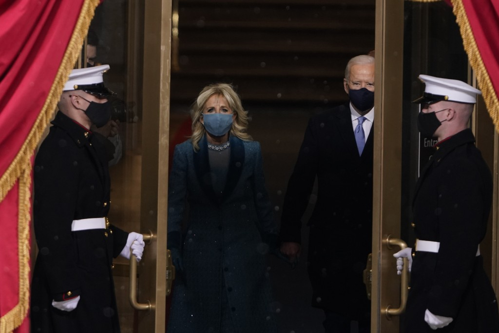 President-elect Joe Biden and his wife Jill, walk out for the 59th Presidential Inauguration at the U.S. Capitol in Washington, Wednesday, Jan. 20, 20...
