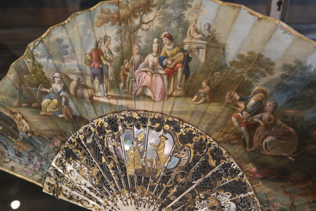 A hand fan representing a musical relaxing moment (detente musicale) is pictured at the hand fan-making museum in Paris, Wednesday, Jan. 20, 2021. Jus...