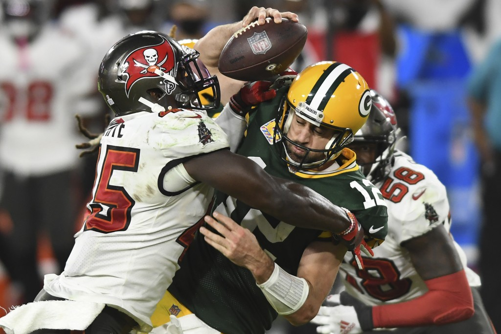 FILE - Tampa Bay Buccaneers inside linebacker Devin White (45) sacks Green Bay Packers quarterback Aaron Rodgers (12) during the second half of an NFL...
