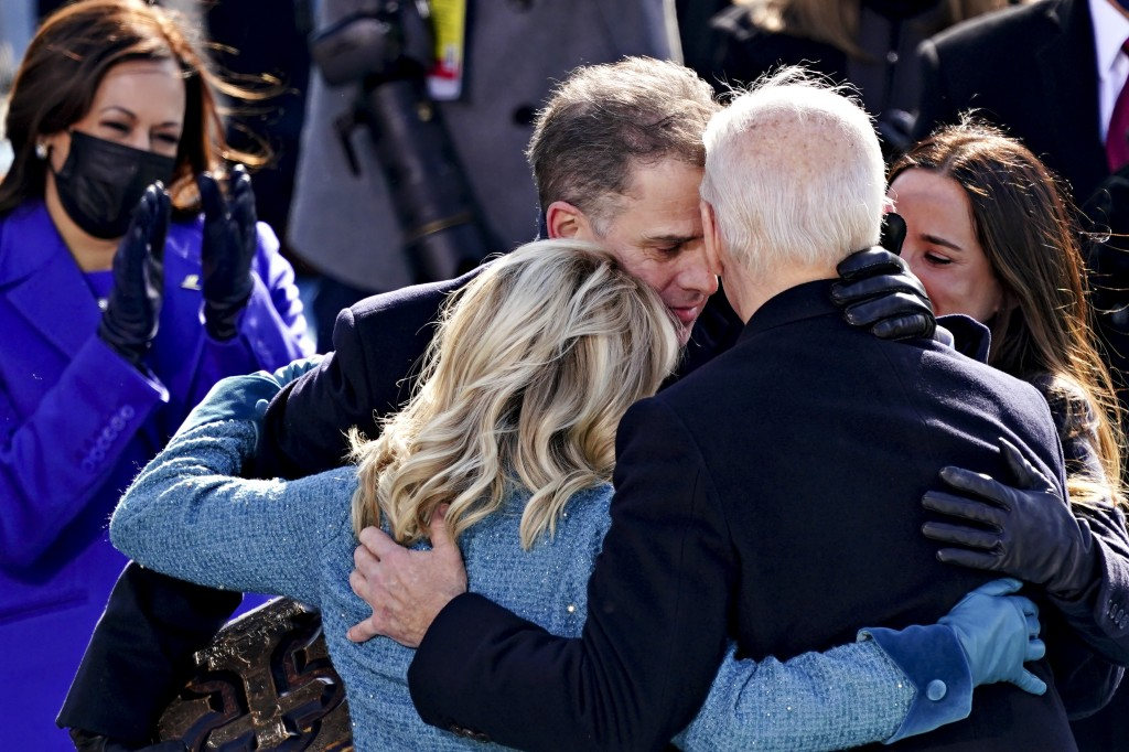 U.S. Vice President Kamala Harris applauds as President Joe Biden is embraced by his son Hunter,  first lady Jill Biden and daughter Ashley, during th...
