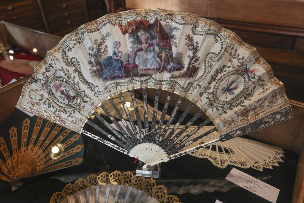A hand fan representing a learned dog (Chien savant), gouache painting on silk dated from 1775, is displayed at the hand fan-making museum in Paris, W...