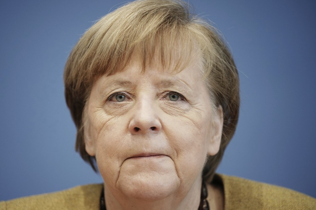 German Chancellor Angela Merkel talks to the media at a press conference on the current situation in Berlin, Germany, Thursday, Jan. 21, 2021. Topics ...