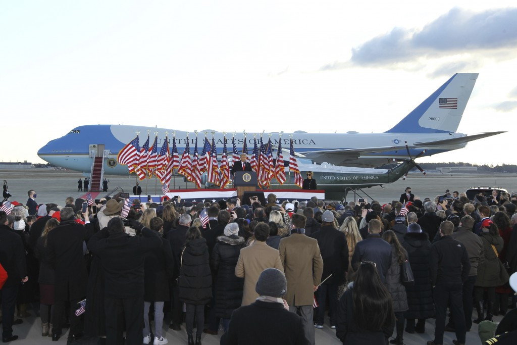 A small crowd of supporter gather to watch President Donald Trump and first lady Melania Trump board Air Force One at Andrews Air Force Base, Md.,Wedn...