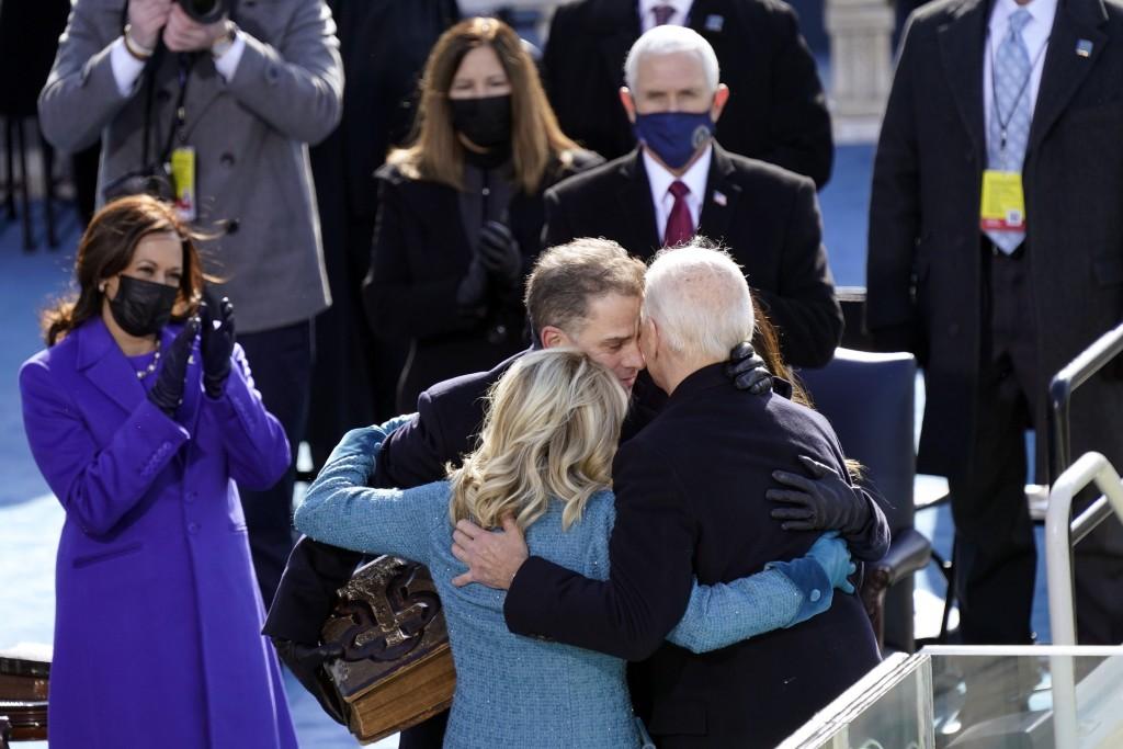 President Joe Biden hugs first lady Jill Biden, his son Hunter Biden and daughter Ashley Biden after being sworn-in during the 59th Presidential Inaug...