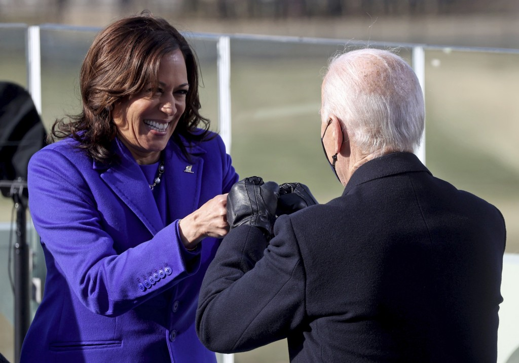 Vice President Kamala Harris bumps fists with President-elect Joe Biden after she was sworn in during the inauguration, Wednesday, Jan. 20, 2021, at t...