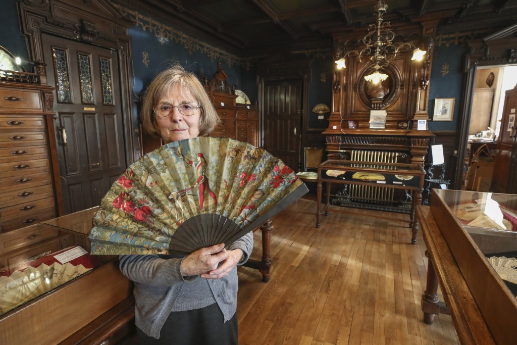 Anne Hoguet, 74, fan maker and director of the hand fan-making museum poses with a a wood roasted hand fan representing the falcon hunt, gouache paint...