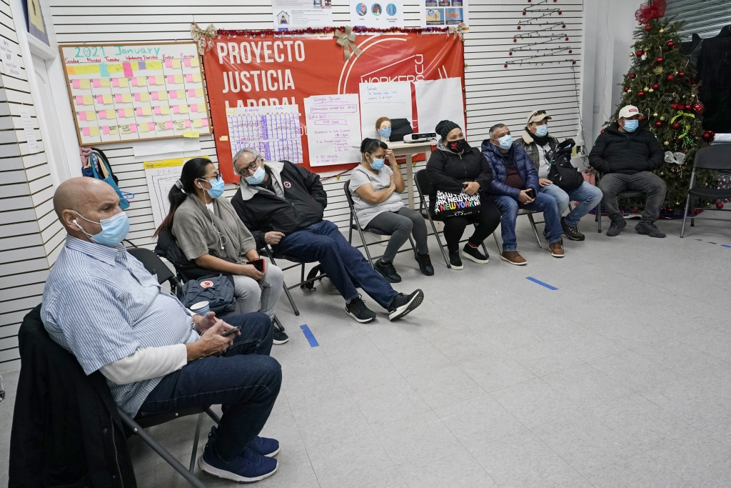 A group of immigrants gather at the Workers Justice Center as they watch Joe Biden's presidential inauguration, Wednesday, Jan. 20, 2021, in the Sunse...