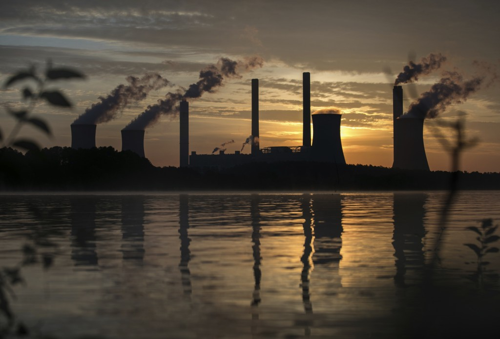 FILE - In this Saturday, June, 3, 2017 file photo, the coal-fired Plant Scherer, one of the nation's top carbon dioxide emitters, stands in the distan...