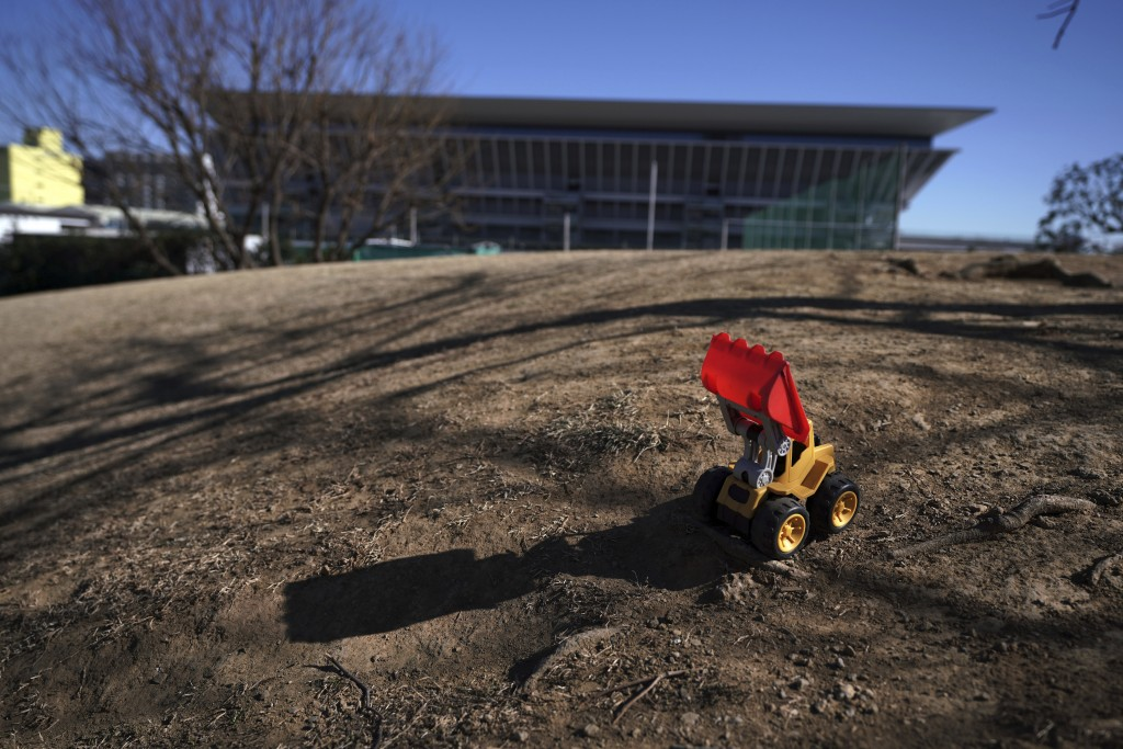 A leftover toy bulldoze is seen near the Tokyo Aquatics Center, one of the venues of Tokyo 2020 Olympic and Paralympic games, in Tokyo Wednesday, Jan....