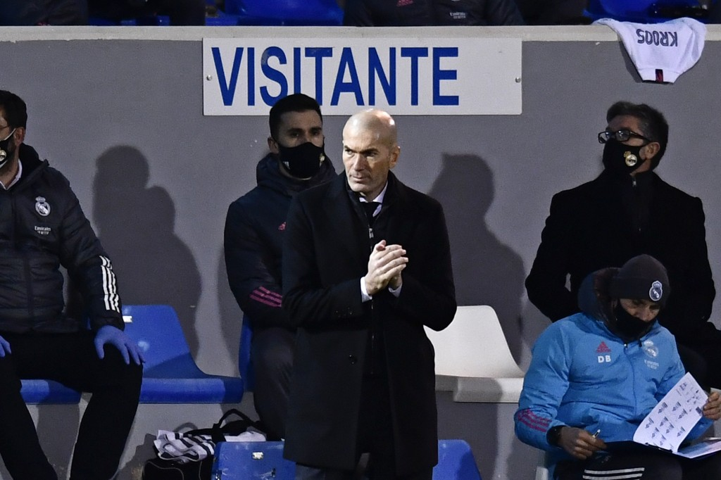 FILE- In this Wednesday, Jan. 20, 2021 file photo, Real Madrid's head coach Zinedine Zidane applauds during a Spanish Copa del Rey round of 32 soccer ...