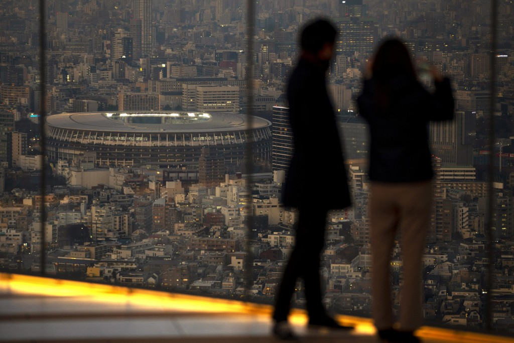 Japan National Stadium, where opening ceremony and many other events are planned for postponed Tokyo 2020 Olympics, is seen from a rooftop observation...