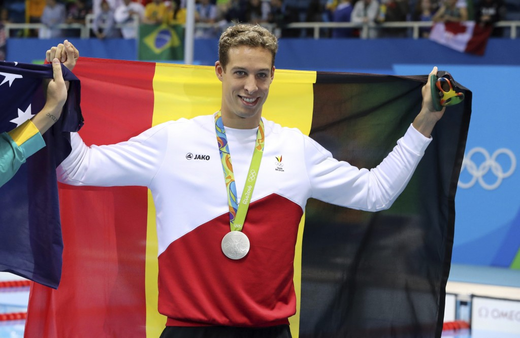 FILE - In this Thursday, Aug. 11, 2016 file photo, Belgium's Pieter Timmers holds up his silver medal after the men's 100-meter freestyle during the s...