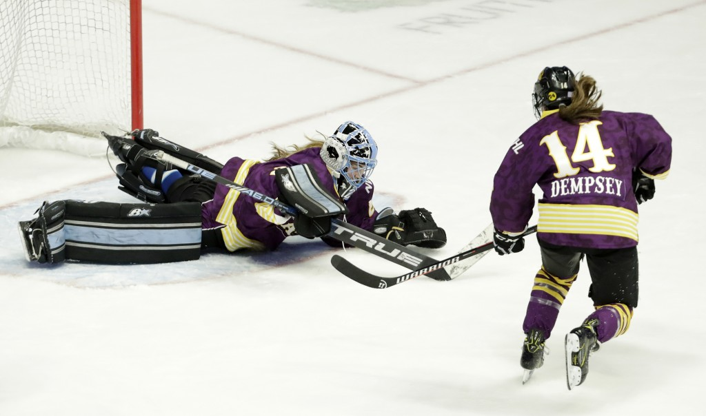 FILE- In this Feb. 10, 2019, file photo, Team Stecklein goalie Nicole Hensley, left, dives on the puck as Jillian Dempsey, right, watches for the rebo...