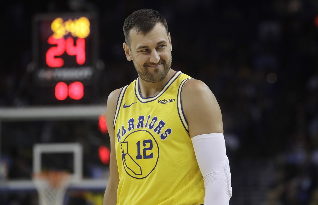 FILE - In this Tuesday, April 2, 2019 file photo, Golden State Warriors center Andrew Bogut looks on during an NBA basketball game against the Denver ...