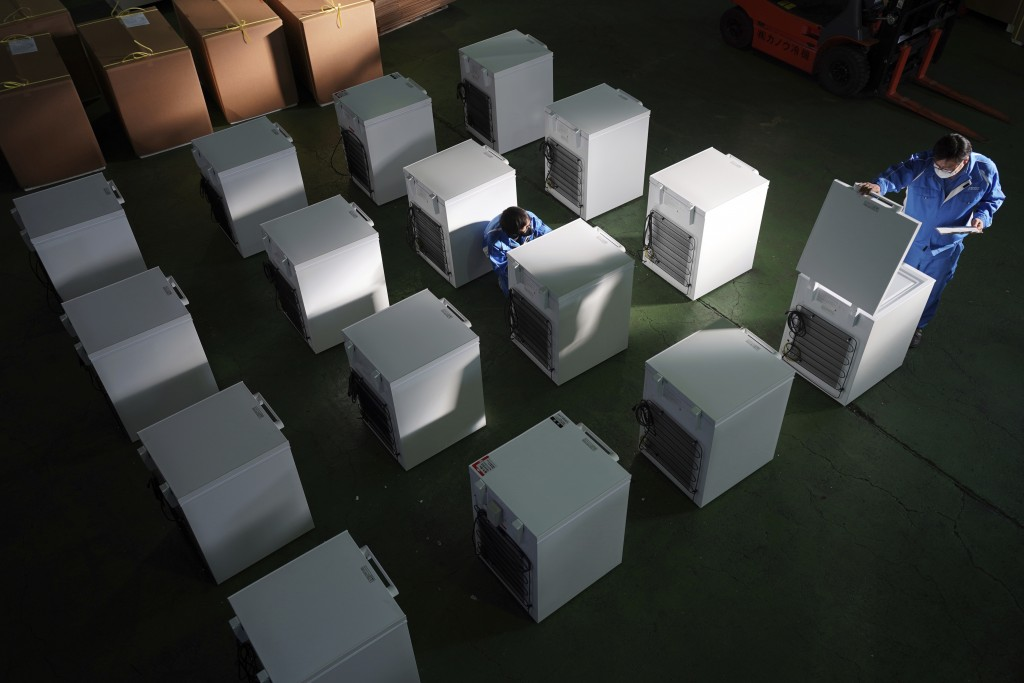 Brand-new ultralow-temperature freezers are seen at a warehouse at Kanou Reiki, a freezer supplier, Friday, Jan. 22, 2021 in Sagamihara, west of Tokyo...