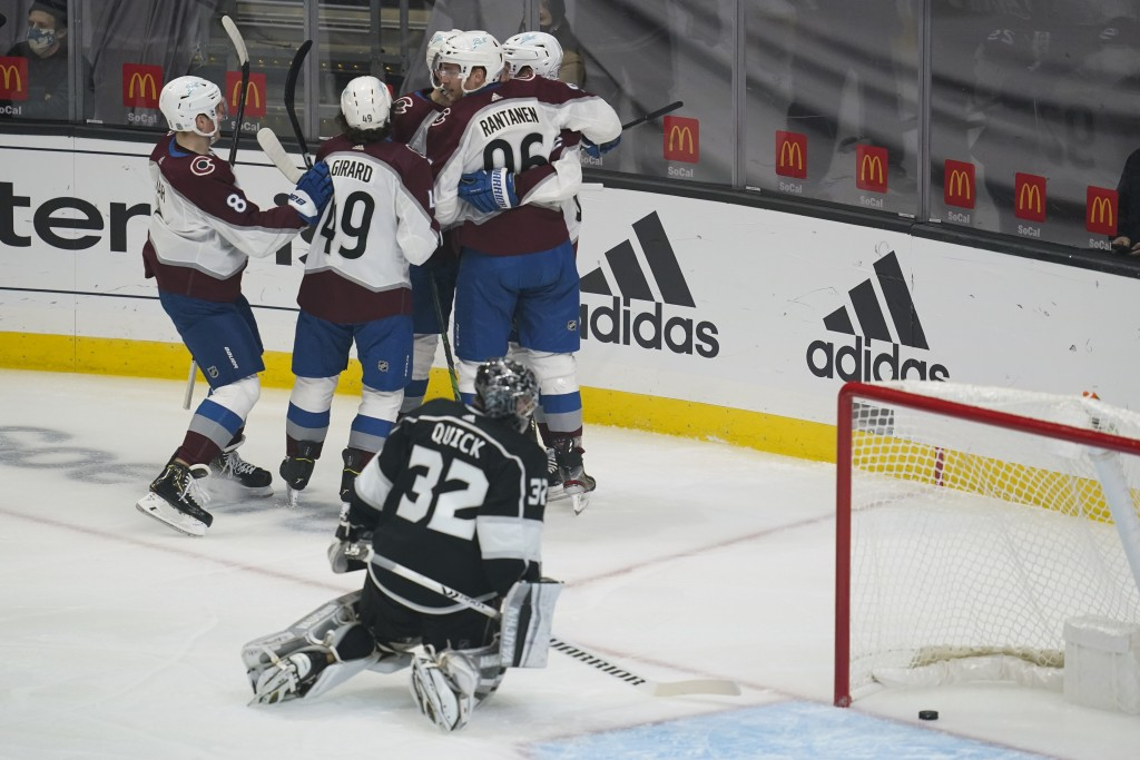 Colorado Avalanche players celebrate after a goal by right wing Mikko Rantanen (96) against the Los Angeles Kings during the first period of an NHL ho...