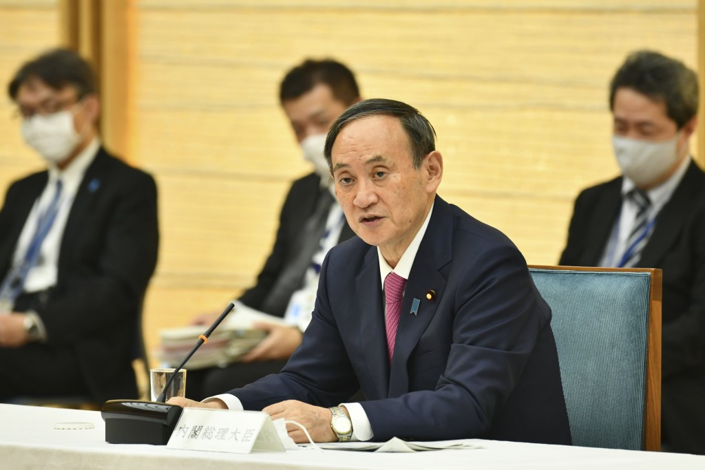 Japanese Prime Minister Yoshihide Suga speaks during a meeting of the coronavirus infection control headquarters at his office in Tokyo Friday, Jan. 2...