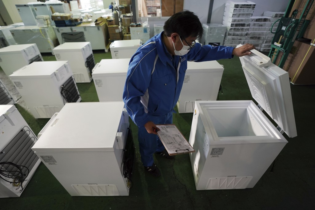 Brand-new ultralow-temperature freezers are seen at warehouse at Kanou Reiki, a freezer supplier, Friday, Jan. 22, 2021 in Sagamihara, west of Tokyo. ...