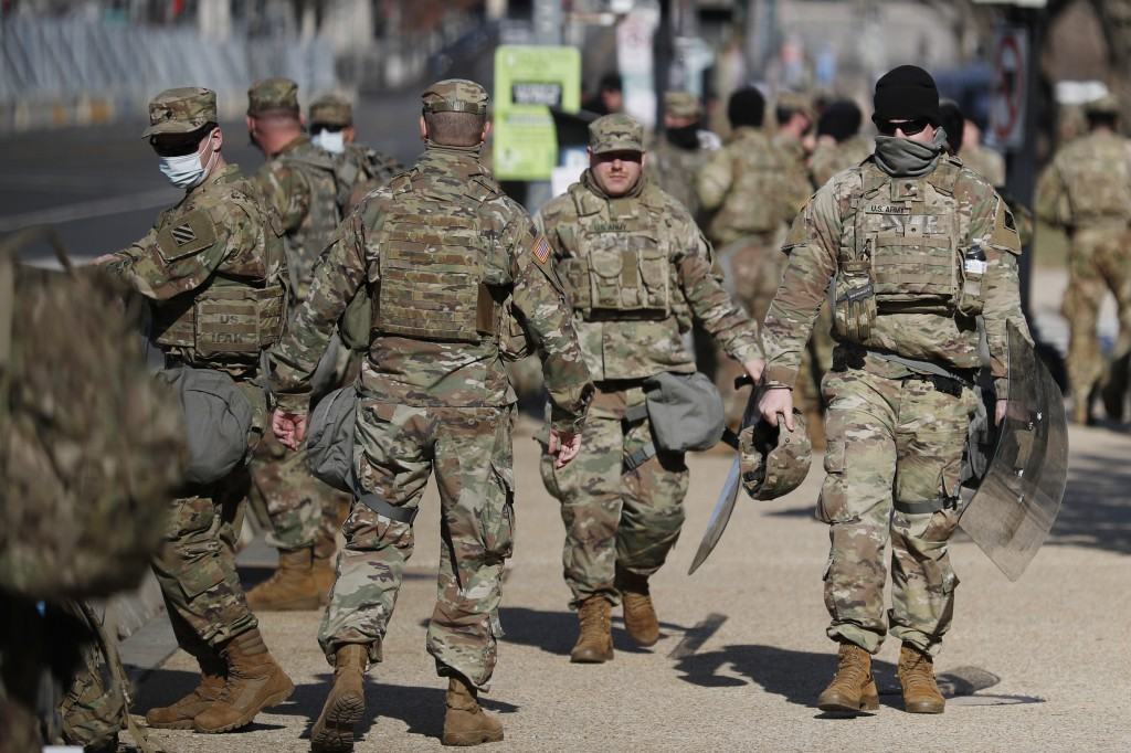 National Guard troops continue to be deployed around the Capitol one day after the inauguration of President Joe Biden, Thursday, Jan. 21, 2021, in Wa...