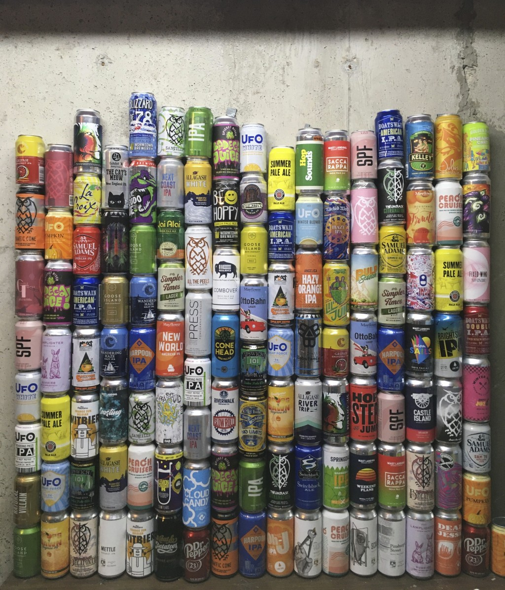 This Jan. 1, 2021 photo shows a collection of empty beer cans, consumed during the pandemic, at a home in North Andover, Mass. This year's Dry January...