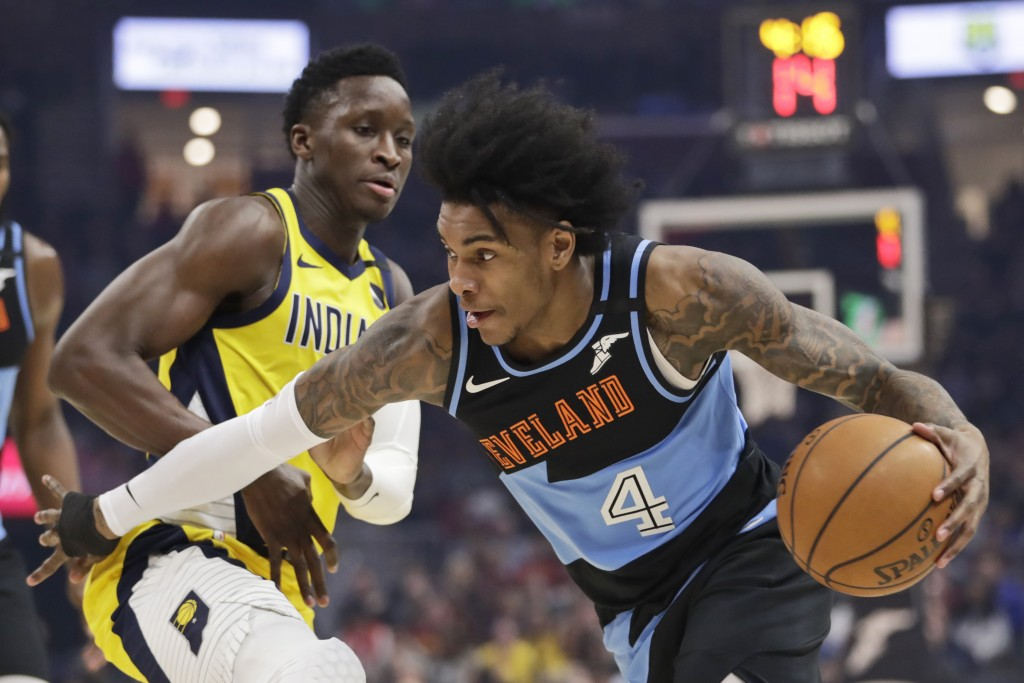 FILE - Cleveland Cavaliers' Kevin Porter Jr., right, drives past Indiana Pacers' Victor Oladipo in the first half of an NBA basketball game in Clevela...