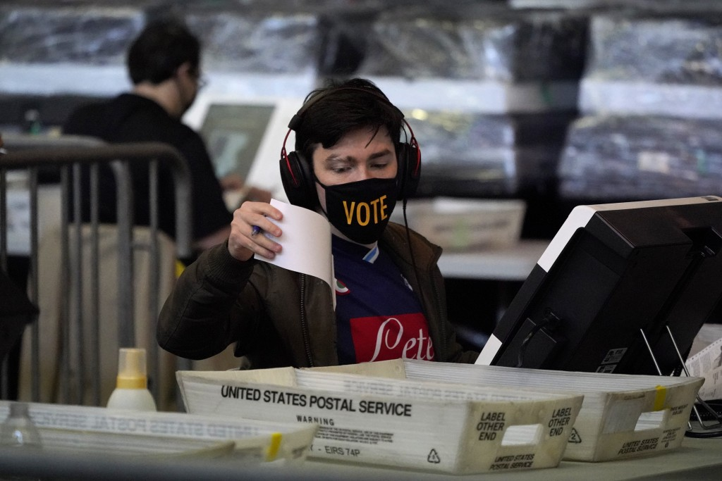 FILE - In this Nov. 6, 2020, file photo, ballots are counted at the Allegheny County Election Division warehouse on the Northside of Pittsburgh. Democ...