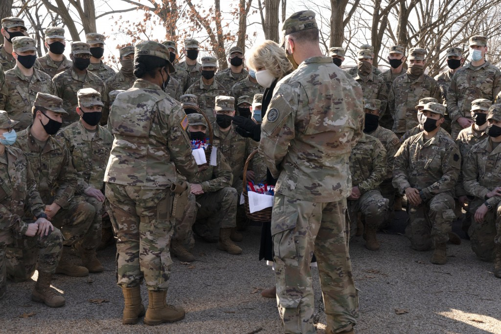 """Saying, """"the Biden's are a National Guard family,"""" first lady Jill Biden talks with soldiers after a group photo while surprising members of the Natio..."""