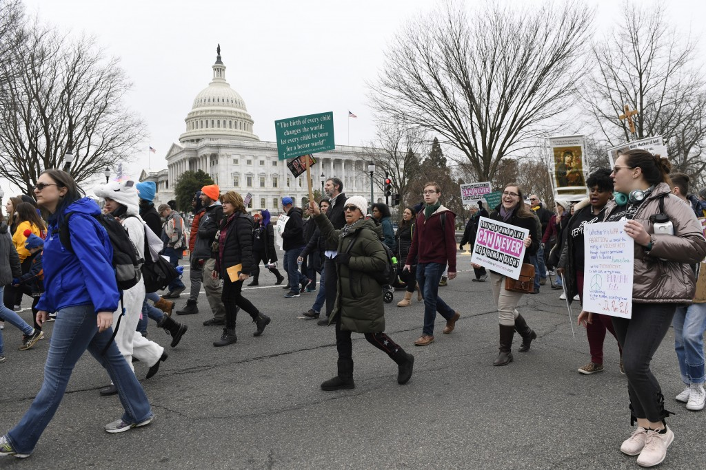 "FILE - In this Jan. 24, 2020, file photo, anti-abortion activists participate in the ""March for Life"" rally near Capitol Hill in Washington. Anti-abor..."