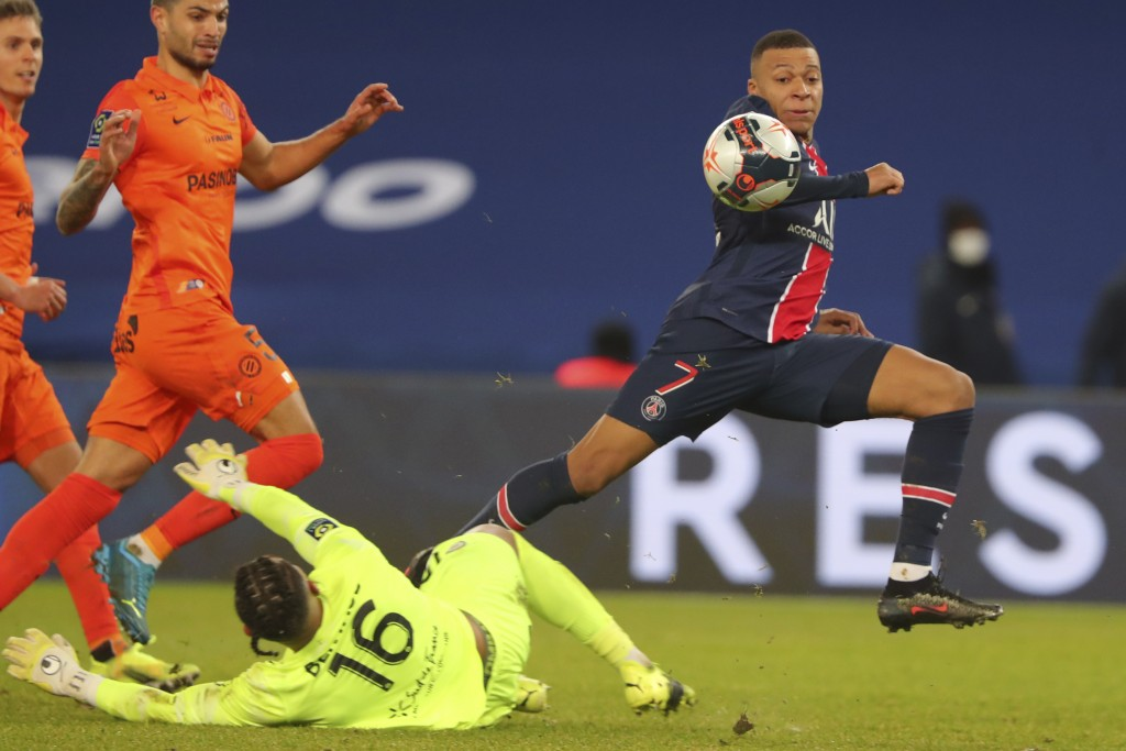 PSG's Kylian Mbappe, right, scores his side's opening goal during the French League One soccer match between Paris Saint-Germain and Montpellier at th...