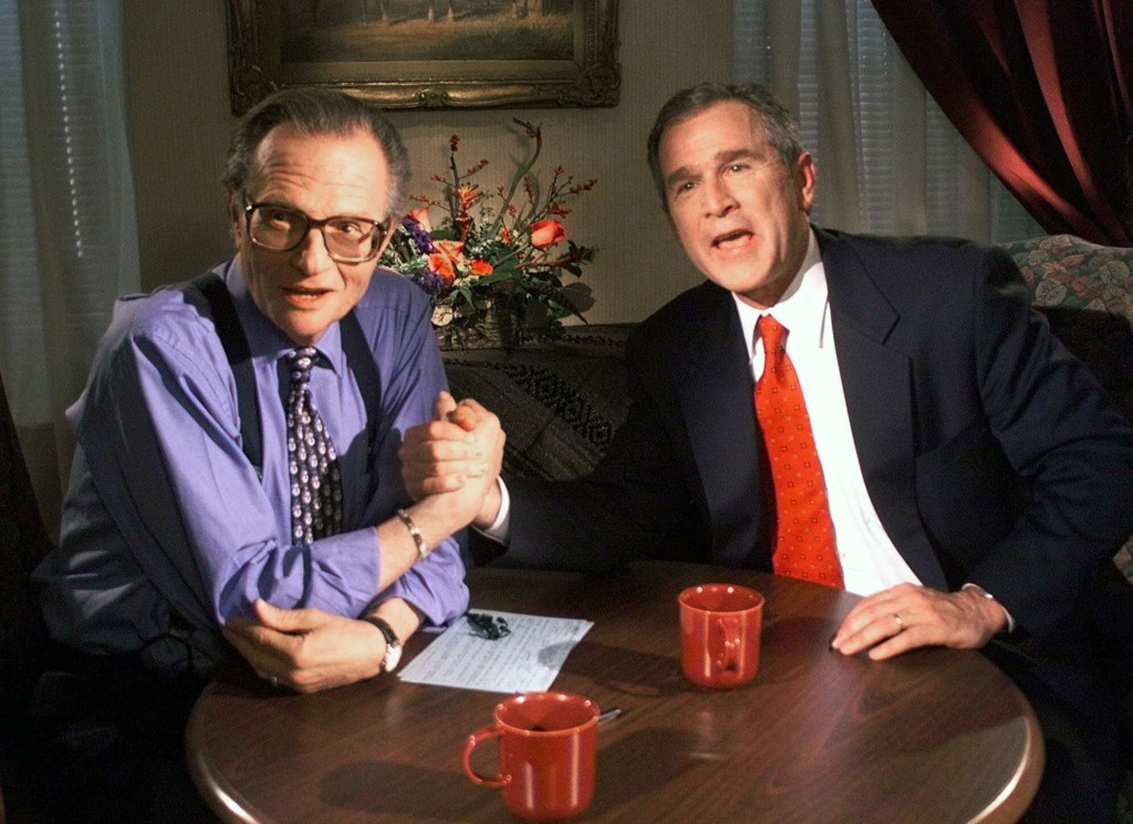 """FILE - In this Dec. 16, 1999 file photo, Republican presidential candidate Texas Gov. George W. Bush jokes with CNN's Larry King after finishing the """"..."""