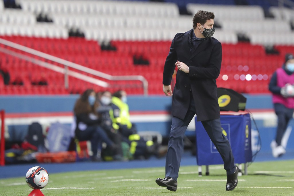 PSG's head coach Mauricio Pochettino moves during the French League One soccer match between Paris Saint-Germain and Montpellier at the Parc des Princ...