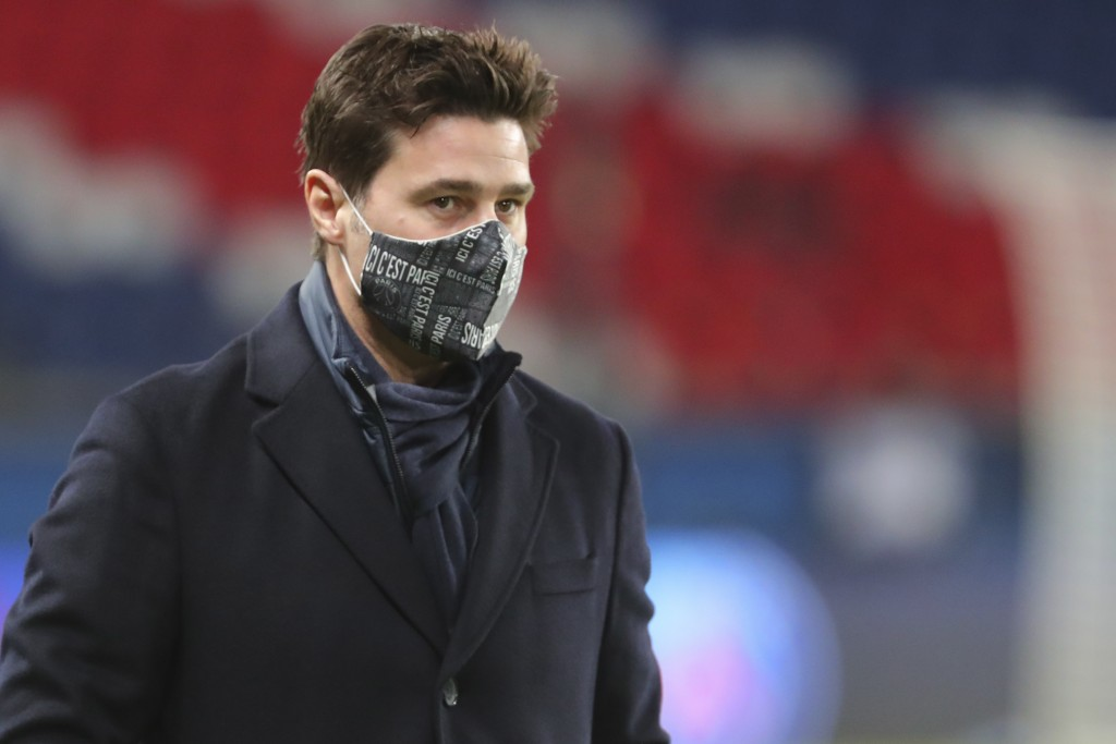 PSG's head coach Mauricio Pochettino looks at the field during the French League One soccer match between Paris Saint-Germain and Montpellier at the P...