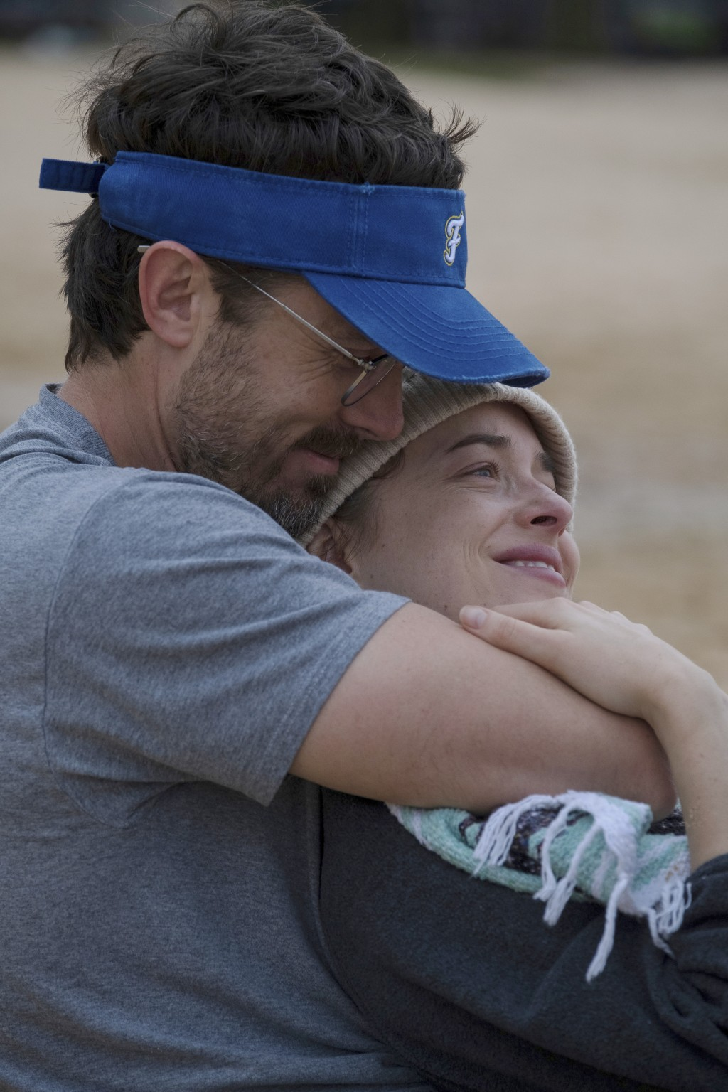 """This image released by Gravitas Ventures shows Casey Affleck, left, and Dakota Johnson in a scene from """"Our Friend."""" (Claire Folger/Gravitas Ventures ..."""