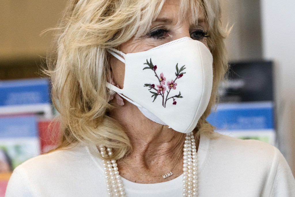 """First lady Jill Biden's necklace says """"Mama,"""" as she takes a tour of Whitman-Walker Health, Friday, Jan. 22, 2021, in Washington.(AP Photo/Jacquelyn ..."""